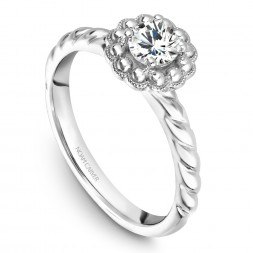 A floral Carver Studio white gold engagement ring with a round center stone.