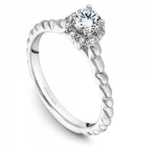 A floral Carver Studio white gold engagement ring with 21 diamonds.