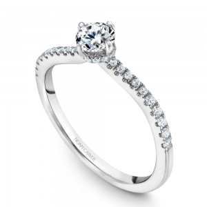 A solitaire Carver Studio white gold engagement ring with 33 diamonds.