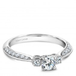 A floral 3-stone Carver Studio white gold engagement ring with 39 diamonds.
