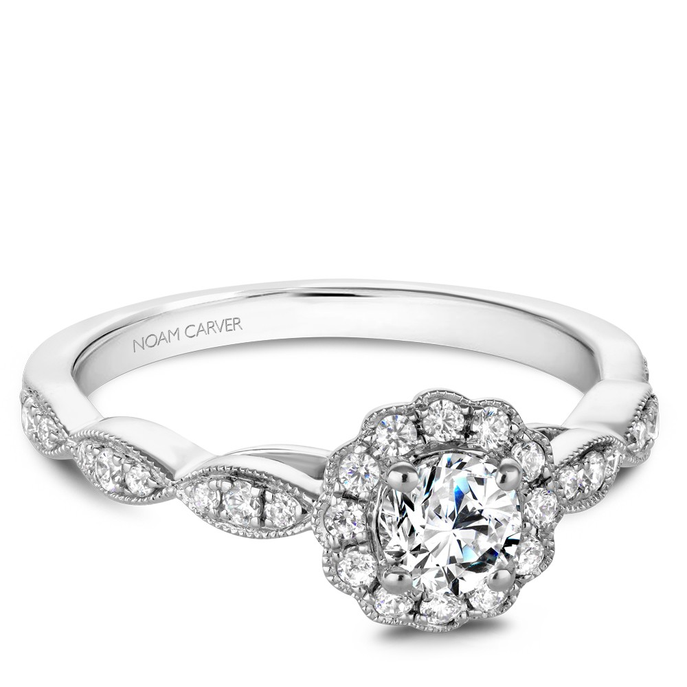 A floral Carver Studio white gold engagement ring with a halo and 31 diamonds.