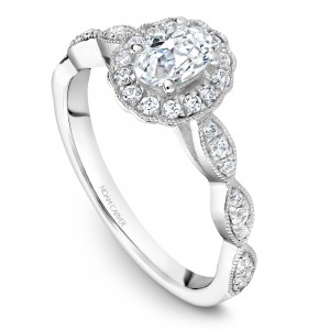 A floral Carver Studio white gold engagement ring with an oval halo and 31 diamonds.