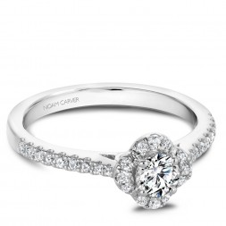 A floral Carver Studio white gold engagement ring with 31 diamonds.