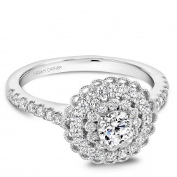 A floral Carver Studio white gold engagement ring with a double halo and 55 diamonds.