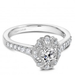A modern Carver Studio white gold engagement ring with 29 diamonds.