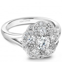 A floral Carver Studio white gold engagement ring with 56 diamonds.