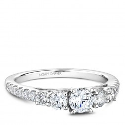 A 3-stone Carver Studio white gold engagement ring with 17 diamonds.