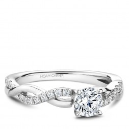 A Carver Studio white gold engagement ring with a twist band and 25 diamonds.