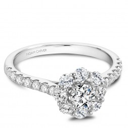 A floral Carver Studio white gold engagement ring with a halo and 23 diamonds.
