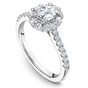 A floral Carver Studio white gold engagement ring with an oval halo and 23 diamonds.