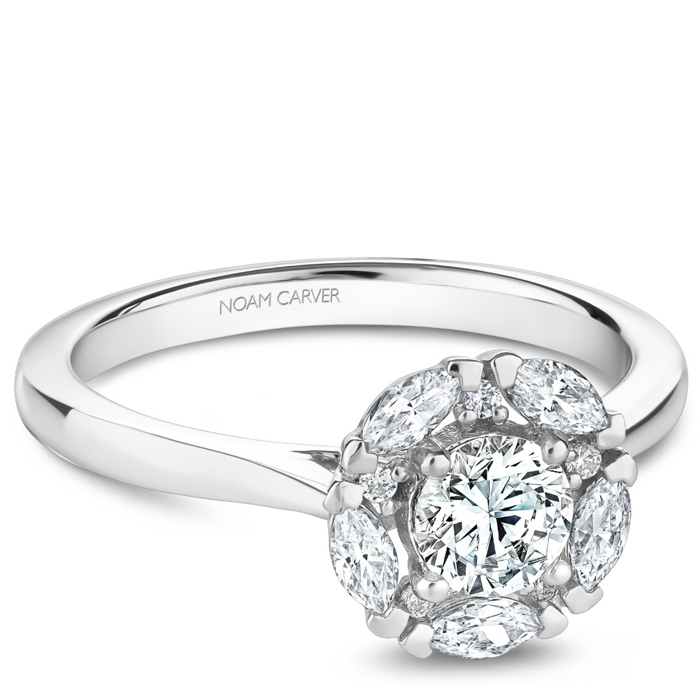 A modern Carver Studio white gold engagement ring with 11 diamonds.
