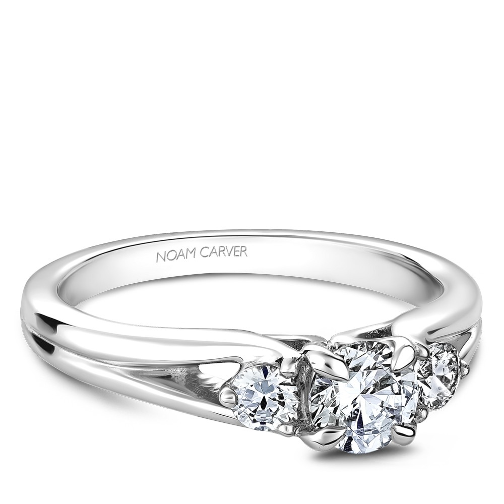 A 3-stone Carver Studio white gold engagement ring.