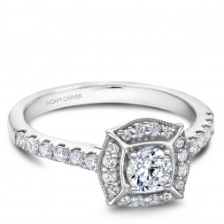 A modern Carver Studio white gold engagement ring and 31 diamonds.