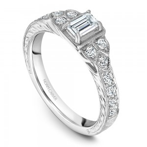 A vintage Carver Studio white gold engagement ring with 16 diamonds.