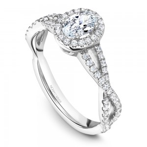 A Carver Studio white gold engagement ring with a twist band, an oval halo and 73 diamonds.