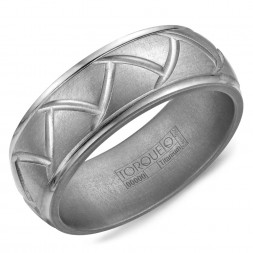 A Titanium Torque Band With A Carved Design.